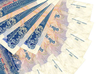 1000 Cambodian riels bills lies isolated on white background with copy space stacked in fan shape close up. Financial transactions concept