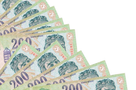 200 Hungarian forint bills lies isolated on white background with copy space stacked in fan close up. Payday time concept or financial operations