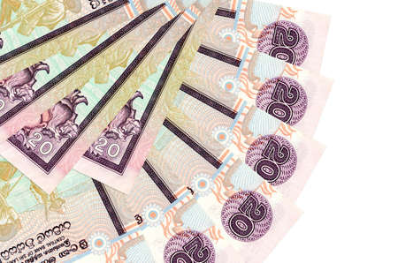 20 Sri Lankan rupees bills lies isolated on white background with copy space stacked in fan shape close up. Financial transactions concept