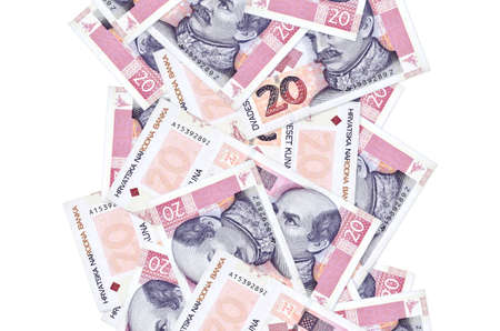 20 Croatian kuna bills flying down isolated on white. Many banknotes falling with white copy space on left and right side