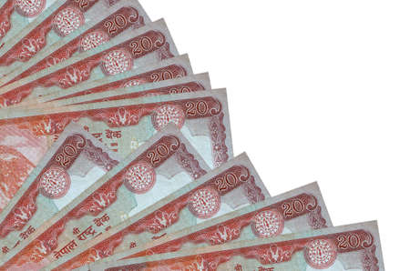 20 Nepalese rupees bills lies isolated on white background with copy space stacked in fan close up. Payday time concept or financial operations