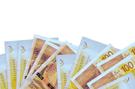 100 Israeli new shekels bills lies on bottom side of screen isolated on white background with copy space. Background banner template for business concepts with money