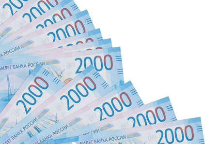 2000 russian rubles bills lies isolated on white background with copy space stacked in fan close up. Payday time concept or financial operations Reklamní fotografie