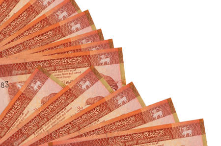 100 Sri Lankan rupees bills lies isolated on white background with copy space stacked in fan close up. Payday time concept or financial operations