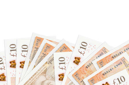 10 British pounds bills lies on bottom side of screen isolated on white background with copy space. Background banner template for business concepts with money