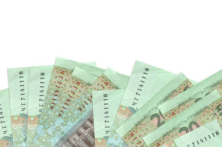 20 Ukrainian hryvnias bills lies on bottom side of screen isolated on white background with copy space. Background banner template for business concepts with money