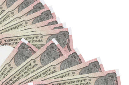 1 Indian rupee bills lies isolated on white background with copy space stacked in fan close up. Payday time concept or financial operations