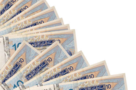 10 Tunisian dinars bills lies isolated on white background with copy space stacked in fan close up. Payday time concept or financial operations