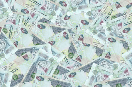 500 UAE dirhams bills lies in big pile. Rich life conceptual background. Big amount of money