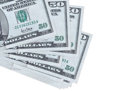 50 US dollars bills lies in small bunch or pack isolated on white. Mockup with copy space. Business and currency exchange concept