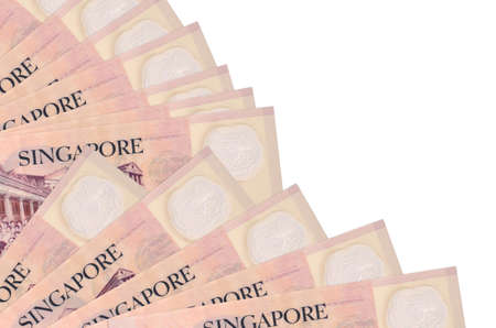 2 Singaporean dollars bills lies isolated on white background with copy space stacked in fan close up. Payday time concept or financial operations