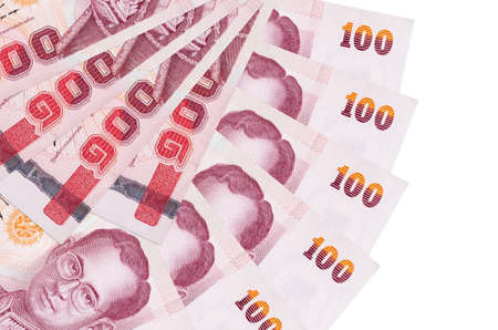 100 Thai Baht bills lies isolated on white background with copy space stacked in fan shape close up. Financial transactions concept