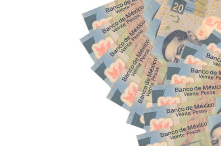 20 Mexican pesos bills lies isolated on white background with copy space. Rich life conceptual background. Big amount of national currency wealth 스톡 콘텐츠