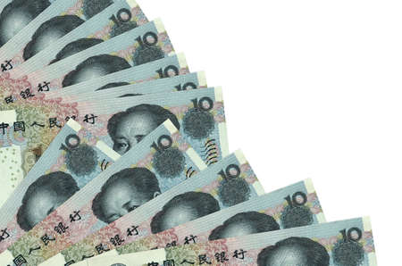 10 Chinese yuan bills lies isolated on white background with copy space stacked in fan close up. Payday time concept or financial operations