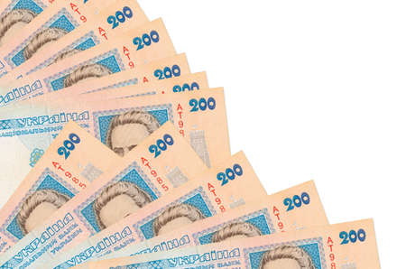 200 Ukrainian hryvnias bills lies isolated on white background with copy space stacked in fan close up. Payday time concept or financial operations 스톡 콘텐츠