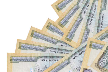 100 Nepalese rupees bills lies in different order isolated on white. Local banking or money making concept. Business background banner