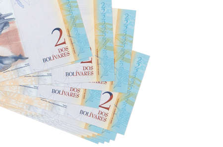 2 Venezuelian bolivar bills lies in small bunch or pack isolated on white. Mockup with copy space. Business and currency exchange concept 스톡 콘텐츠