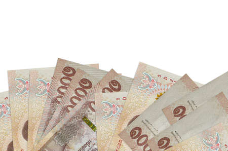 1000 Thai baht bills lies on bottom side of screen isolated on white background with copy space. Background banner template for business concepts with money 스톡 콘텐츠