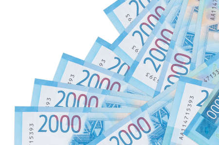 2000 russian rubles bills lies in different order isolated on white. Local banking or money making concept. Business background banner 스톡 콘텐츠
