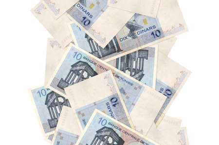 10 Tunisian dinars bills flying down isolated on white. Many banknotes falling with white copy space on left and right side 스톡 콘텐츠