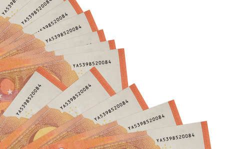 10 euro bills lies isolated on white background with copy space stacked in fan close up. Payday time concept or financial operations 스톡 콘텐츠