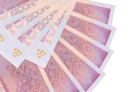 10 Estonian kroon bills lies isolated on white background with copy space stacked in fan shape close up. Financial transactions concept 스톡 콘텐츠