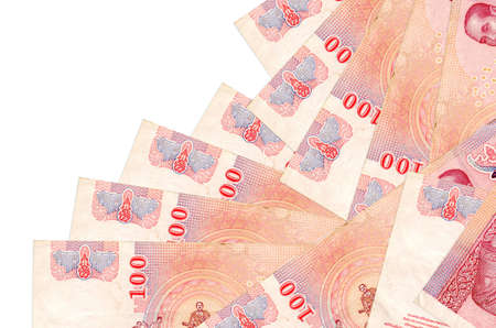 100 Thai Baht bills lies in different order isolated on white. Local banking or money making concept. Business background banner