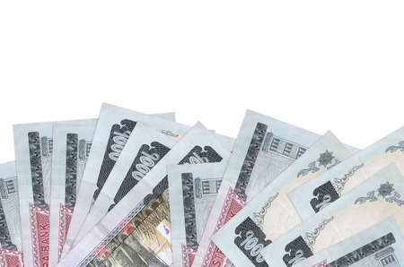 1000 Nepalese rupees bills lies on bottom side of screen isolated on white background with copy space. Background banner template for business concepts with money