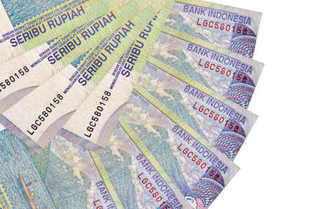 1000 Indonesian rupiah bills lies isolated on white background with copy space stacked in fan shape close up. Financial transactions concept