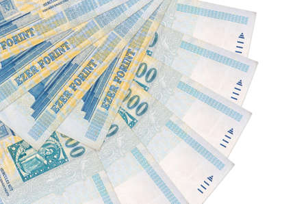 1000 Hungarian forint bills lies isolated on white background with copy space stacked in fan shape close up. Financial transactions concept 스톡 콘텐츠