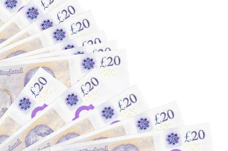 20 British pounds bills lies isolated on white background with copy space stacked in fan close up. Payday time concept or financial operations 스톡 콘텐츠