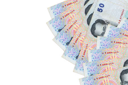 50 Thai Baht bills lies isolated on white background with copy space. Rich life conceptual background. Big amount of national currency wealth