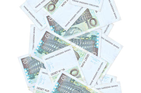 10 Croatian kuna bills flying down isolated on white. Many banknotes falling with white copy space on left and right side