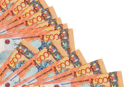 5000 Kazakhstani tenge bills lies isolated on white background with copy space stacked in fan close up. Payday time concept or financial operations