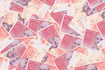 10 Estonian kroon bills lies in big pile. Rich life conceptual background. Big amount of money 스톡 콘텐츠