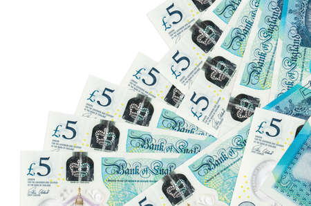 5 British pounds bills lies in different order isolated on white. Local banking or money making concept. Business background banner
