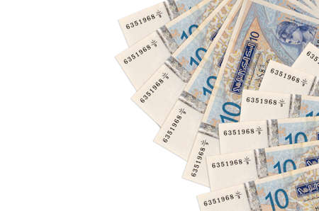 10 Tunisian dinars bills lies isolated on white background with copy space. Rich life conceptual background. Big amount of national currency wealth