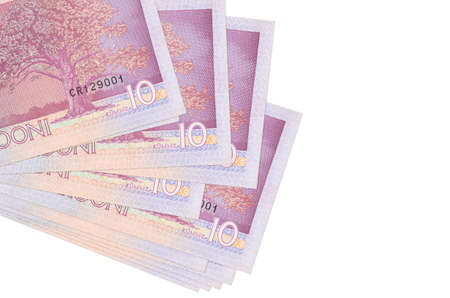 10 Estonian kroon bills lies in small bunch or pack isolated on white. Mockup with copy space. Business and currency exchange concept