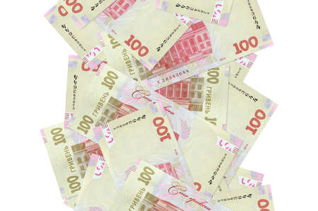 100 Ukrainian hryvnias bills flying down isolated on white. Many banknotes falling with white copy space on left and right side 版權商用圖片