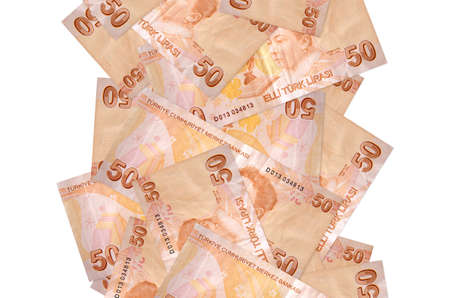 50 Turkish liras bills flying down isolated on white. Many banknotes falling with white copy space on left and right side