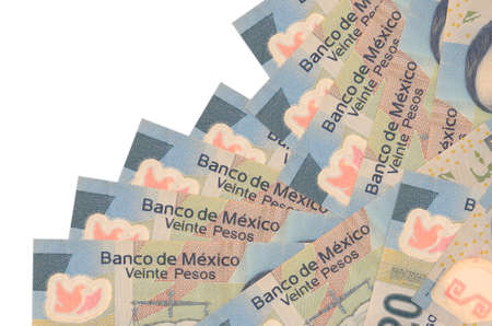 20 Mexican pesos bills lies in different order isolated on white. Local banking or money making concept. Business background banner