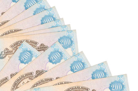 200 Ukrainian hryvnias bills lies isolated on white background with copy space stacked in fan close up. Payday time concept or financial operations 版權商用圖片