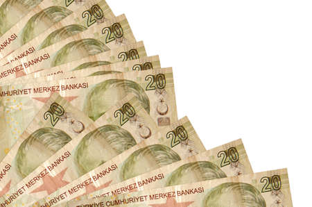 20 Turkish liras bills lies isolated on white background with copy space stacked in fan close up. Payday time concept or financial operations