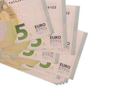 5 euro bills lies in small bunch or pack isolated on white. Mockup with copy space. Business and currency exchange concept