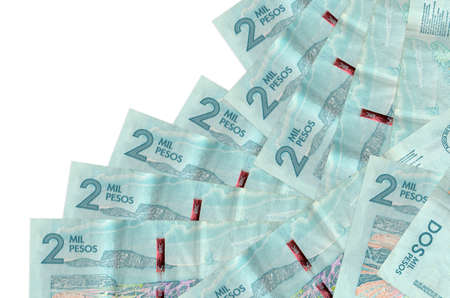 2 Colombian pesos bills lies in different order isolated on white. Local banking or money making concept. Business background banner