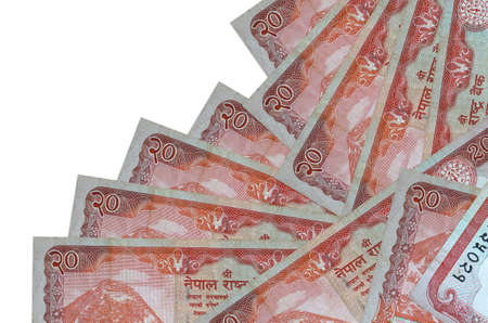 20 Nepalese rupees bills lies in different order isolated on white. Local banking or money making concept. Business background banner 版權商用圖片