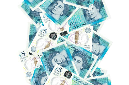 5 British pounds bills flying down isolated on white. Many banknotes falling with white copy space on left and right side