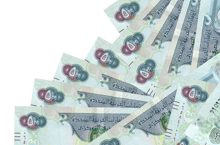 500 UAE dirhams bills lies in different order isolated on white. Local banking or money making concept. Business background banner