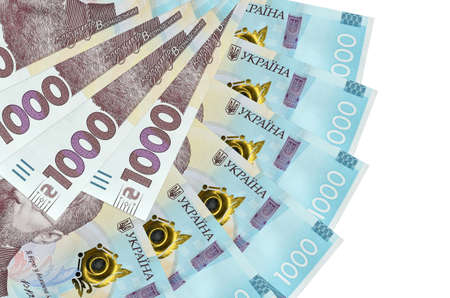 1000 Ukrainian hryvnias bills lies isolated on white background with copy space stacked in fan shape close up. Financial transactions concept