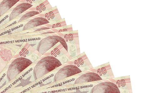 10 Turkish liras bills lies isolated on white background with copy space stacked in fan close up. Payday time concept or financial operations